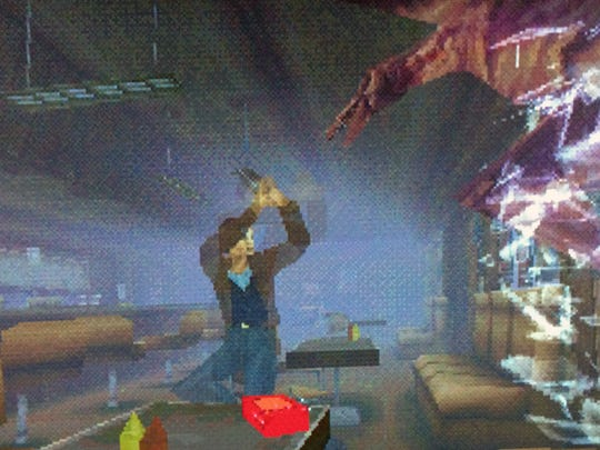 "A flying monster crashes through a cafe window to attack Harry in ""Silent Hill."""
