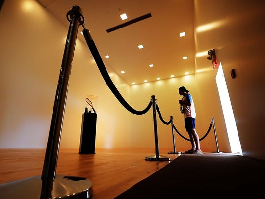 Once the display space for jumpsuits and gold records, the racquetball court at Graceland has been converted back to its original form, and Elvis fans can view his gold racket.