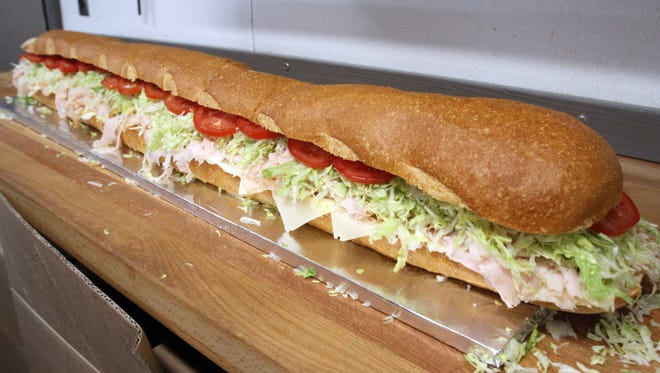 Table feature on the best subs in Central Jersey at Tastee Subs at 267 Plainfield Ave, Edison on Saturday May 9 , 2015.