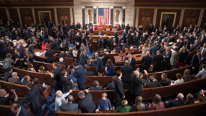 Members of the House of Representatives, some joined by family, gather in the House chamber on Capitol Hill in Washington, Tuesday, Jan. 3, 2017, as the 115th Congress gets under way. (AP Photo/J. Scott Applewhite) ORG XMIT: DCSA105