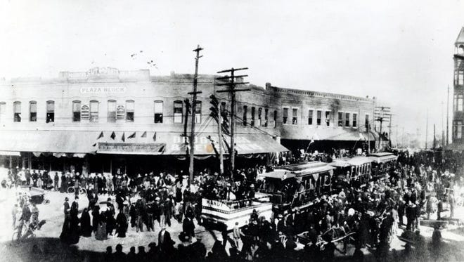 This photo from Jan. 11, 1902, shows crowds gathered around electric streetcars making  their inaugural run after nearly 30 years of mule-drawn streetcars. The new electric cars are pushing a smaller vehicle in front on which Mandy the Mule (the streetcar mules were all named Mandy) is being given a ride around town.