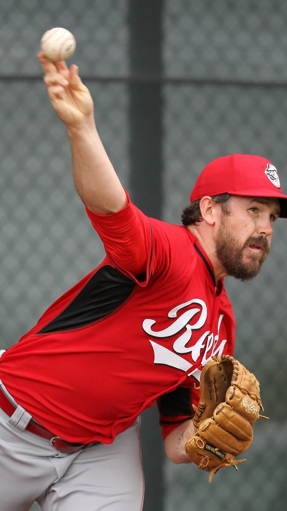 Reds pitcher Sam LeCure throws in the bullpen at spring