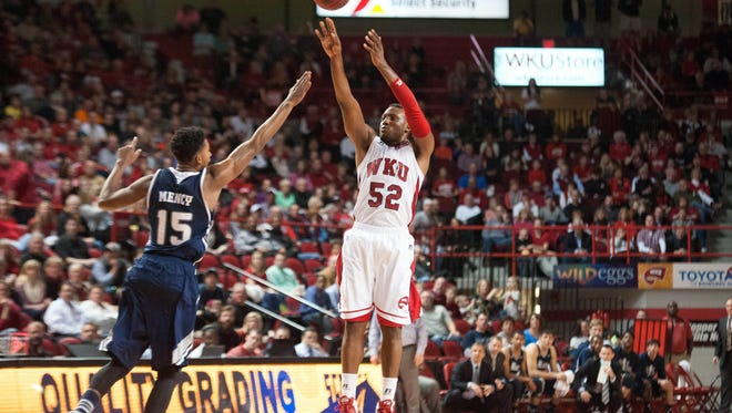 Feb 7, 2015; Bowling Green, KY, USA; Western Kentucky Hilltoppers guard T.J. Price (52) shoots the ball over Rice Owls guard Bishop Mency (15) during the second half at E.A. Diddle Arena. Mandatory Credit: Joshua Lindsey-USA TODAY Sports