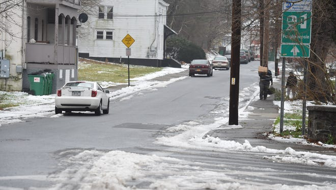 A storm left some snow on the ground at the intersection of North Bridge Street and Verazzano Boulevard in the City of Poughkeepsie on Dec. 30.
