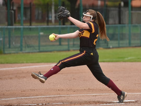 Mercy pitcher Julia Crowley (24) delivers the pitch.
