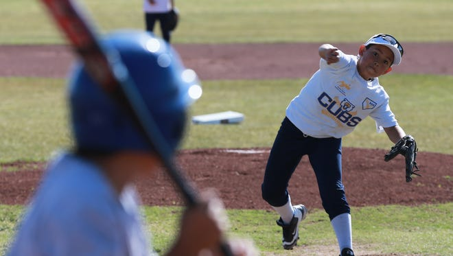 Israel Rubio of the Cubs pitches during a game. Rubio, a student at W.D. Surratt Elementary, and the Cubs are part of BASE Play, a free after-school program offered by the El Paso Border Youth Athletic Association for elementary schoolchildren in the Clint Independent School District.