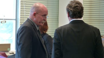 James Benno, left, confers with defense attorney Joseph Tully after it was learned jurors were deadlocked in two felony counts.