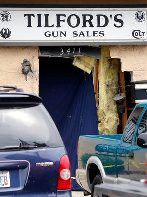 LMPD officials say Tilford's Gun Sales, on Fern Valley Road, was robbed early Wednesday morning after a stolen vehicle crashed into the building.July 27, 2016