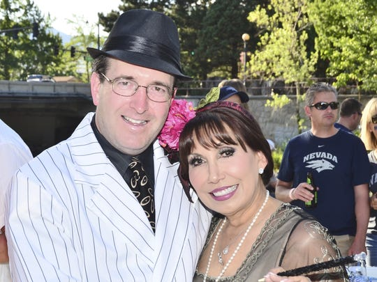 "Stephen and Ellie Lopez-Bowlan dress in ""Chicago"" costume at Pops on the River, the Reno Philharmonic's celebration of Broadway"