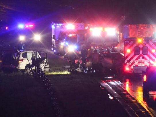 Emergency personnel work at the scene of a head-on