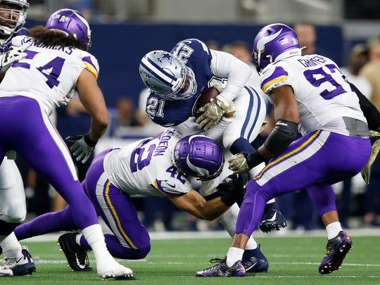 Nov 10, 2019; Arlington, TX, USA; Dallas Cowboys running back Ezekiel Elliott (21) is tackled by Minnesota Vikings outside linebacker Ben Gedeon (42) in the game at AT&T Stadium. Mandatory Credit: Tim Heitman-USA TODAY Sports