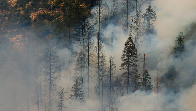 Smoke rises from the Slide Fire in Oak Creek Canyon near Sedona on Friday, May 23, 2014.