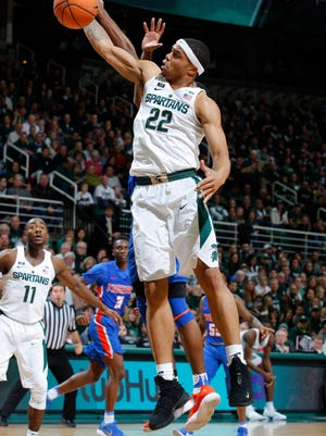 Michigan State's Miles Bridges (22) pulls down one of his career-high 21 rebounds against Savannah State on Sunday. Bridges' 19 defensive rebounds were a school record.
