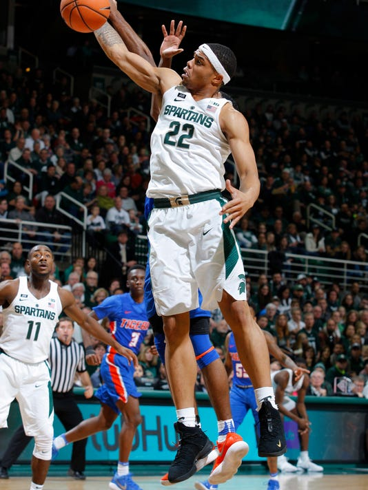 Michigan State's Miles Bridges (22) pulls down a rebound against Savannah State during the first half of an NCAA college basketball game, Sunday, Dec. 31, 2017, in East Lansing, Mich. (AP Photo/Al Goldis)