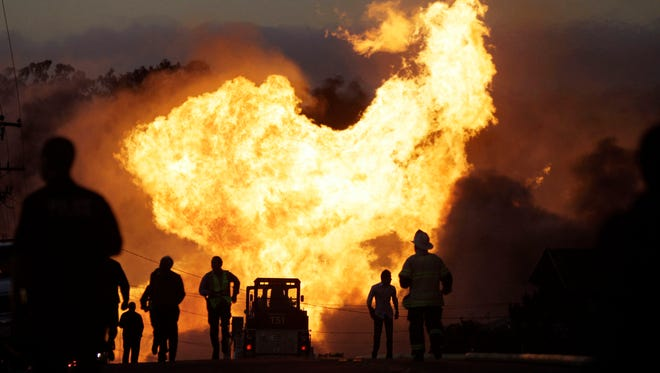 A massive fire roars through a residential neighborhood in San Bruno, Calif., in this 2010 photo.