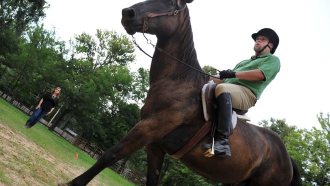 Equestrian Kyle Dutiel of Brandon trains with volunteer Coach Camie Crowe of Ridgeland at Heavenly Hills Farm in Madison for the upcoming 2015 Special Olympics World Summer Games in Los Angeles.