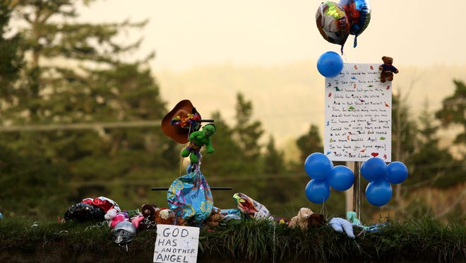 Balloons and stuffed animals rest at the south end of the Yaquina Bay Bridge in Newport  on Thursday Nov. 6, 2014, in Salem, Ore. The items were placed on the bridge in memory of 6-year-old London McCabe.