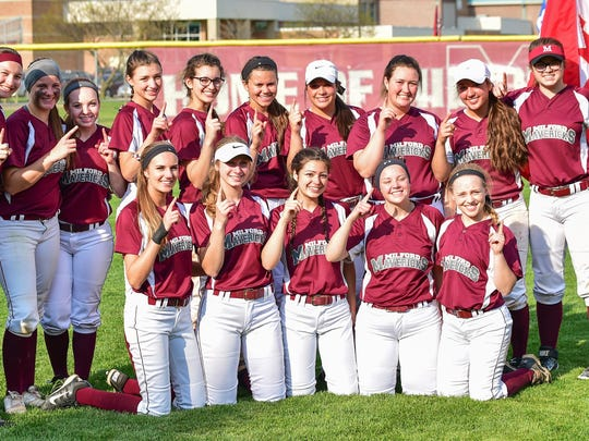 The Milford girls softball team celebrates their first-ever