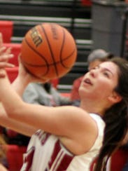 Lady Cat Brooke Huerta takes a hard drive to the basket