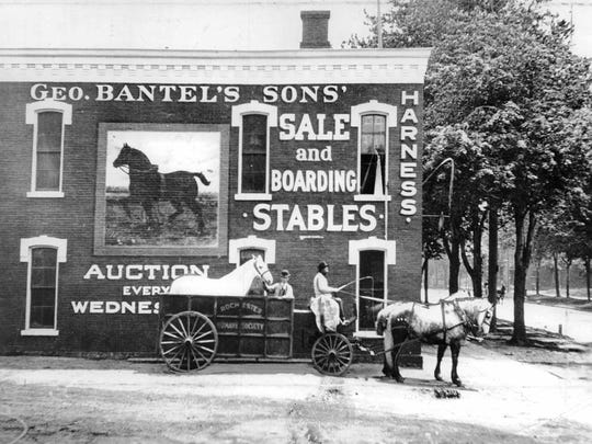A Rochester Humane Society cart is parked outside George Bantel and Sons' stables.