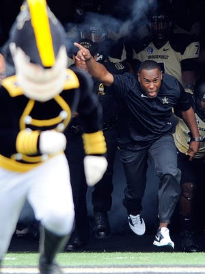 Vanderbilt coach Derek Mason, right, and the Commodores will face nearby non-conference foes Western Kentucky and Middle Tennessee State this season.
