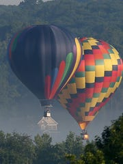 Hot-air balloons take part in the Hudson Valley Balloon Festival at Barton Orchards July 8.