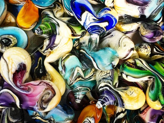 Glass artist Amber Higgins makes her own glass hearts.