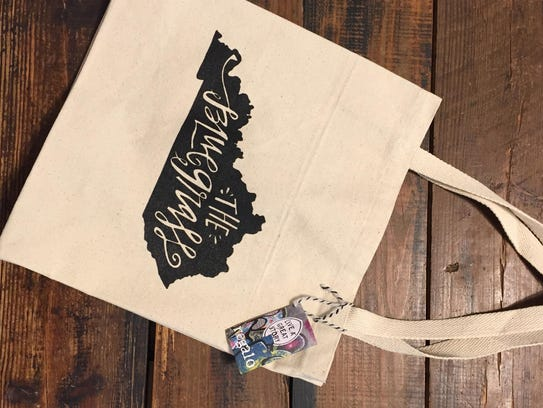 Grab this canvas tote ($16) from Regalo, 562 S. Fourth