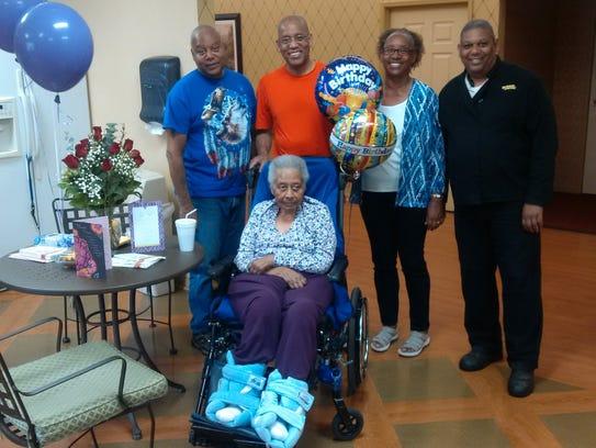 Front, Geraldine Kimbro celebrates her 81st birthday