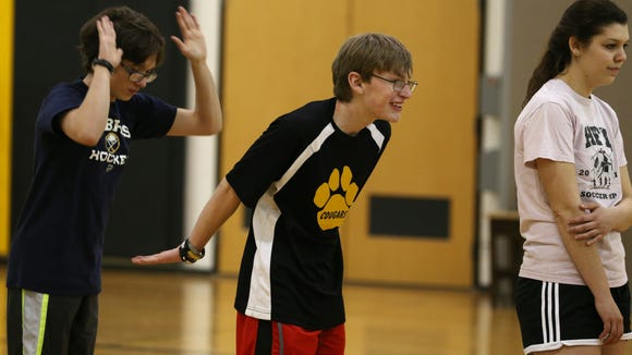 Gavin Germonto, left, and teammate Skyler Smith  congratulate each other on free-throw shooting during practice for Honeoye Falls-Lima. They're part of the school's unified basketball team.