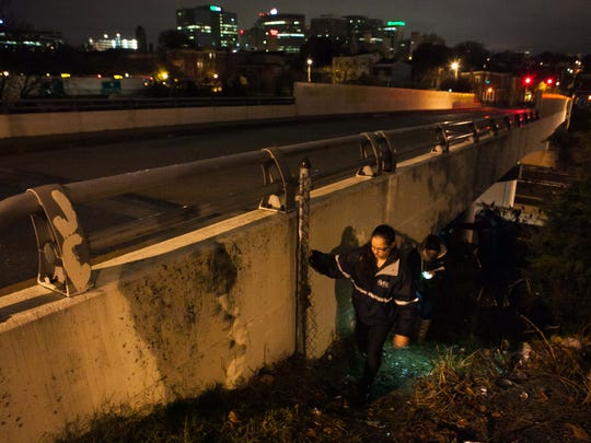 Vicky Kahlbaugh, program director for PATH, and other volunteers come out from under the overpasse on I-95 where they talked to a homeless man who is sleeping there.