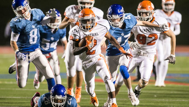 Central York's Noreaga Goff (2), breaks free for a huge run during the third quarter of a York-Adams Division I league football game against Spring Grove Friday, Oct. 14, 2016, at Papermakers Stadium in Spring Grove. Central York won 35-21. Amanda J. Cain photo
