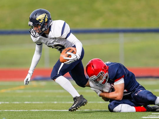 Susquehanna Valley's Edwin Lavin gets tripped up by Chenango Forks' Jakob Topa.