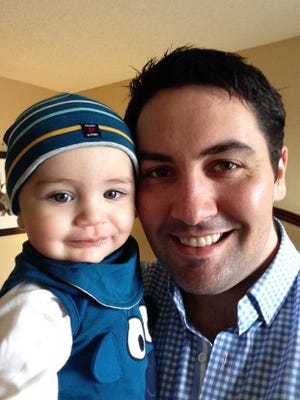 Mark Hehir with son Elliot. He decided to move his family back to Ireland because of  gun issues in the U.S.