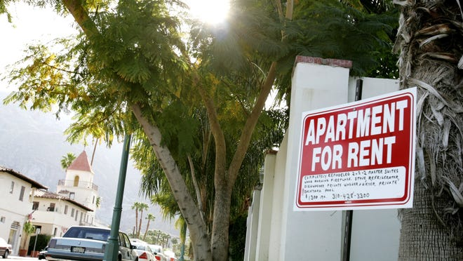 A sign stating an apartment is for rent is posted on the corner of Tamarisk Road at Indian Canyon Drive in Palm Springs on Thursday, April 20, 2006.