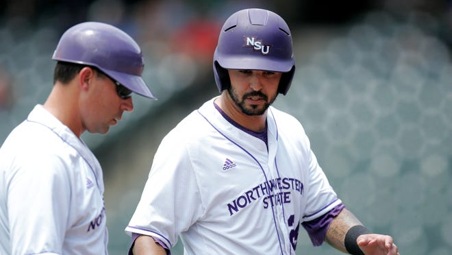 Northwestern State senior designated hitter CJ Webster (right) speaks with Demons coach Lane Burroughs during NSU's 4-1 loss Wednesday in the first round of the Southland Conference Tournament. Webster was the only NSU player with multiple hits as the Demons managed just five hits off Houston Baptist pitcher Matthew McCullough.