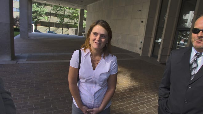 Christine Belford in September 2009 following a court hearing. Federal prosecutors in court Friday showed the footage from a surveillance camera that caught the moment Thomas Matusiewicz shot and killed Belford in 2013.