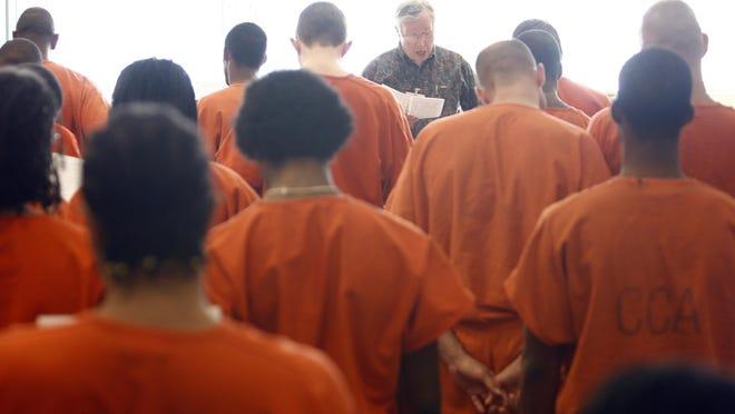 Rev. Thomas Fox visits Marion County Jail II, for an English language service, Thursday, January 22, 2009.