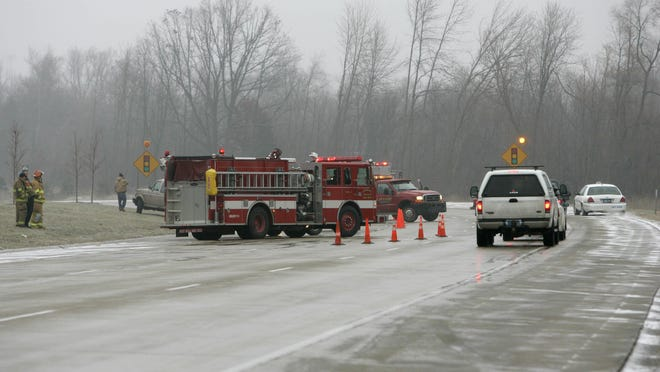 A law signed Thursday by Gov. Rick Snyder mandates that motorists slow by 10 mph below the posted speed limit and, if possible, move over a lane when passing a police or emergency vehicle on the side of the road.