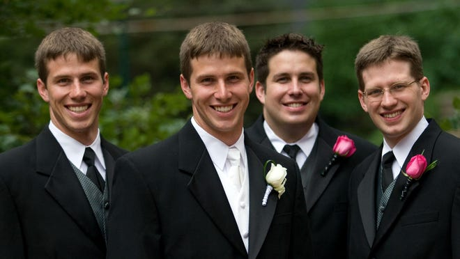 The four Henn sons, pictured in 2008, when all were on their way to becoming surgeons. From left: Curt, Matt, Lucas and Frank.