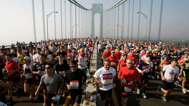This is a Nov. 6, 2005, file photo showing runners on the upper level of the Verrazano Bridge at the start of the 36th New York City Marathon. The New York City Marathon scheduled for Nov. 1, 2020, has been cancelled because of the coronavirus pandemic. New York Road Runners announced the cancellation of the world's largest marathon Wednesday, June 24, 2020, after coordinating with the mayor's office and deciding the race posed too many health and safety concerns for runners, volunteers, spectators and others.