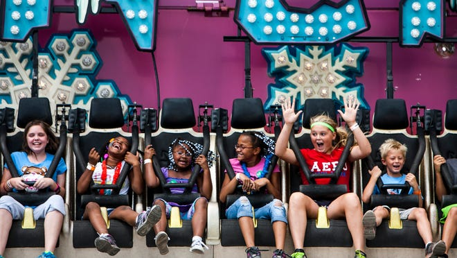 Youth scream as they are tossed in a circle on the Avalanche ride in the Midway during the Illinois State Fair at the Illinois State Fairgrounds, Friday, Aug. 10, 2012, in Springfield, Ill. Justin L. Fowler/The State Journal-Register