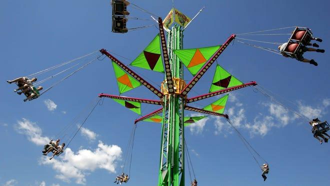 Fairgoers ride Vertigo at a past Winnebago County Fair.