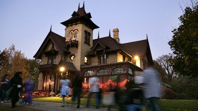 Trick-or-treaters approach the Spafford House on North Prospect Street in Rockford. The Spafford House is well-known throughout the city for its Halloween decorations and treats.
