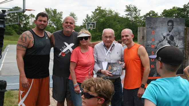 Gary and Cindi Gray, second and third from left, are pictured June 18, 2019, during their Hot Rock basketball camp at their home outside Adrian. With them are, from left, son Doug Gray; Gary Gray's father, Jack Gray; and son Brad Gray. Jack Gray was among a group of individuals being inducted into the camp's hall of fame. The Hot Rock camp was one of the volunteer efforts cited by the Lenawee Community Foundation in awarding the 2020 Lenawee Leadership Award to Cindi and Gary Gray and the 2020 Stubnitz Award to Doug Gray.