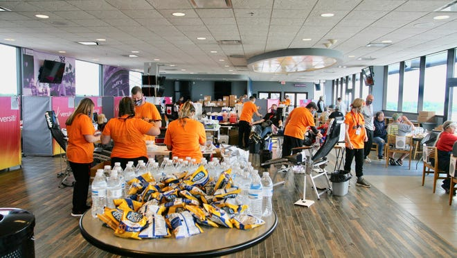 A table full of snacks is seen on a table at Michigan International Speedway as Versiti Blood Center of Michigan staff work with blood donors Friday during the Spirit of America Blood Drive.