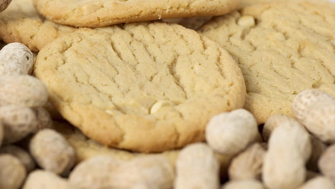 Baking peanut butter cookies makes the kitchen smell delicious.