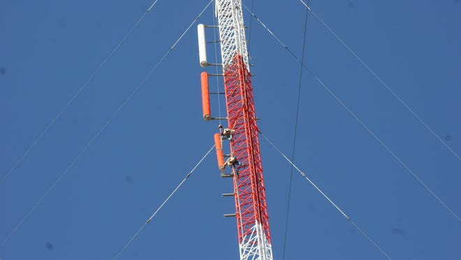 Workers in September 2009 install two antenna sections for a new PBS transmitter on the 560-foot-high KRTV tower in Great Falls. PBS shows, in digital and high definition, became widely available in Great Falls in 2010 after a successful fundraiser. NBC affiliate KBGF went digital this fall.