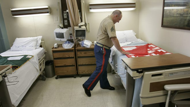 New patients at the VA Hospital in Indianapolis wait an average of 42 days for an appointment. In this photo from 2008, Quilts of Valor are prepared for patient beds.