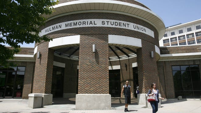 Students walk out of the Hulman Memorial Student Union on the Indiana State University campus in Terre Haute.